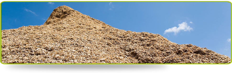 A mound of woodchip, picturesque against the blue sky
